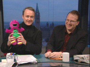 Liberal campaign advisor Warren Kinsella displays a Barney the Dinosaur stuffed toy as he discusses Canadian Alliance leader Stockwell Day's creationist beliefs during an appearance on Canada AM, November 16, 2000. At right is Tim Powers, Canadian Alliance election strategist. To go with Southam News story by Kate Jaimet. (Mandatory credit CTV ' Canada AM)